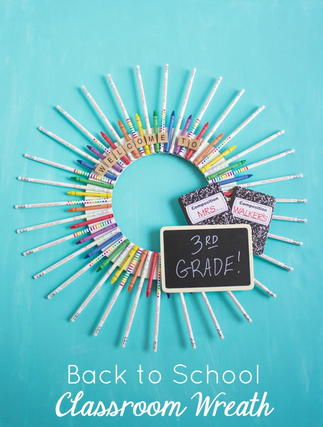 This classroom wreath made from school supplies is the perfect teacher gift idea for back-to-school! #teachergift #backtoschoolcrafts #schoolsupplywreath #classroomwreath #teacherwreath