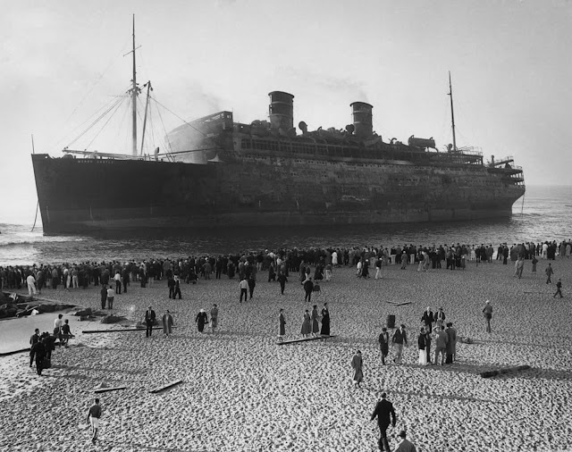 By mid-morning, the ship was totally abandoned and its burning hull drifted ashore, coming to a stop in shallow water off Asbury Park, New Jersey.