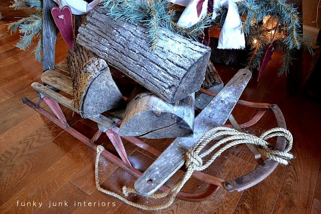 Firewood on sleigh at base of Christmas tree / The making of a stepladder Christmas tree, via : https://www.funkyjunkinteriors.net/