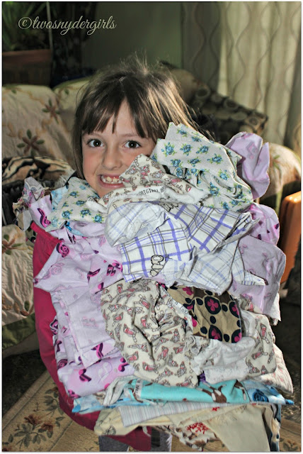 child holding fabric scraps
