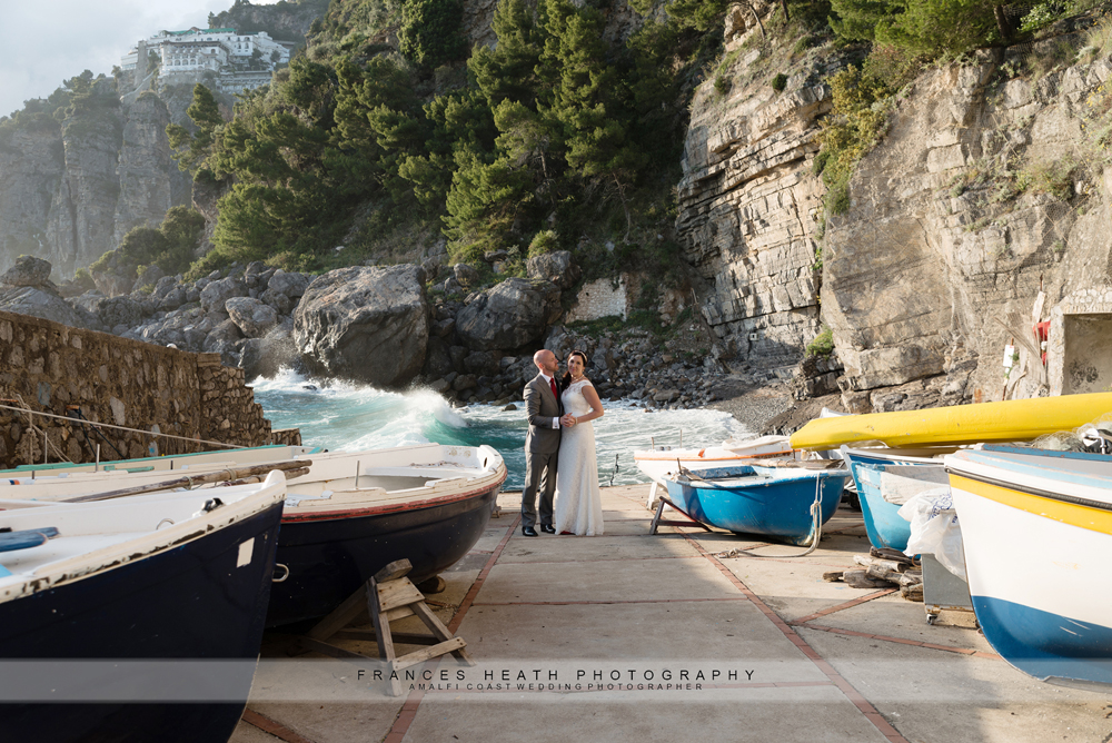 Bride and groom with fishing boats