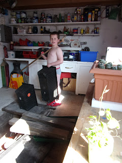 boy in pants with broomstick