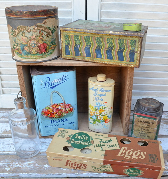 collection of vintage tins, cardboard egg carton, Listerine bottle