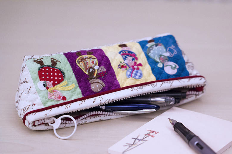 Cosmetic bag or pencil case. Application of fabric and embroidery. DIY step-by-step tutorial.