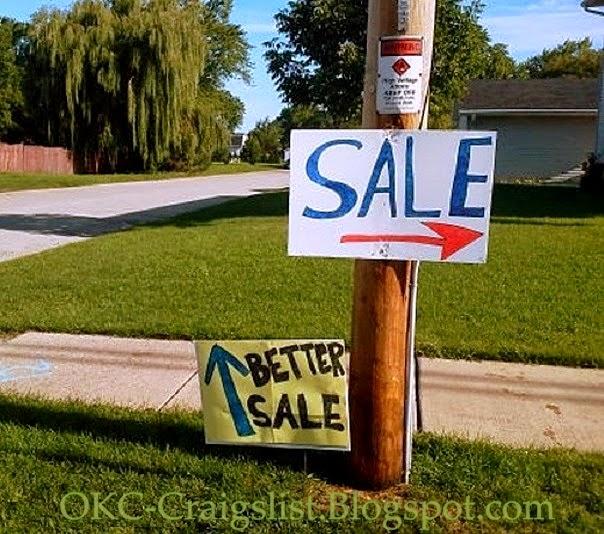 garage sale sign of the week dueling garage sale signs