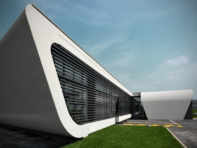 Photo of white facade with black blinds on Gazoline Petrol Station by Damilano Studio Architects