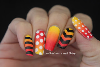Bold stripe and polka dot nail art