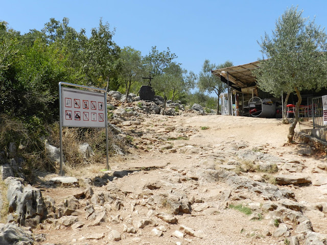 At the base of Cross Mountain, where there is a sign, guidelines for pilgrims