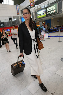 Sonam Kapoor in Spects and deep neck gown Air Port Fashion