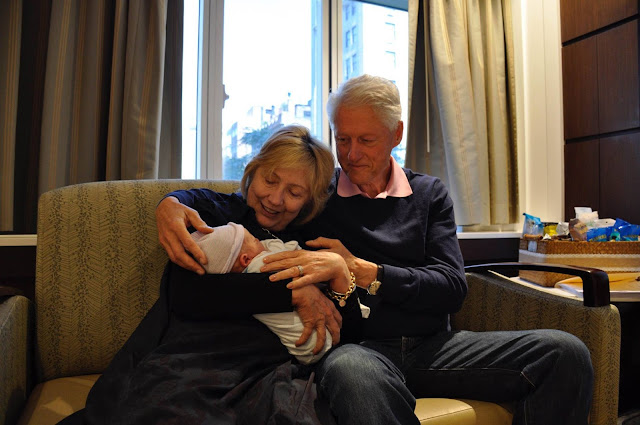 Bill Clinton and Hillary Clinton with new grandson Aiden