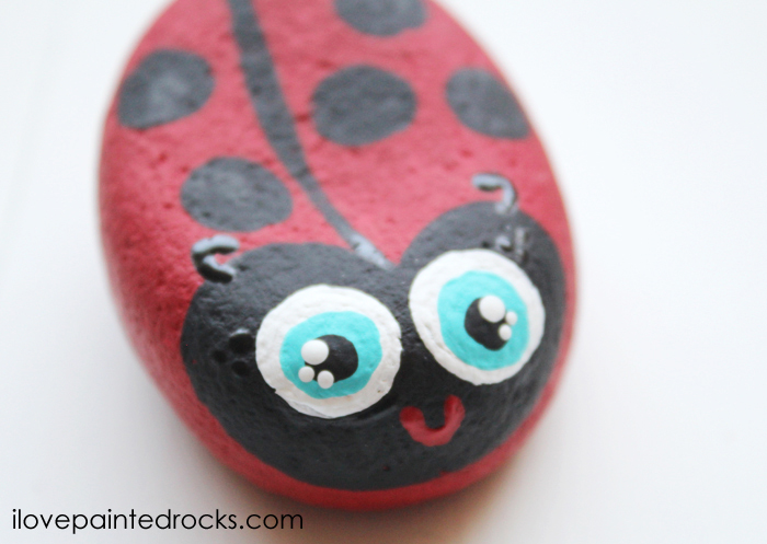 how to paint a ladybug rock. this is a super easy rock painting tutorial that is easy enough for kids