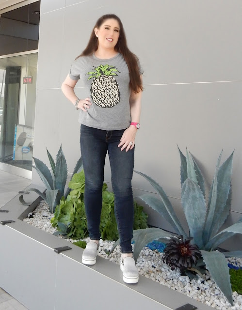 SheIn Pineapple t-shirt on Marisa Stewart the high heeled brunette with Stella McCartney glitter tennis shoes.
