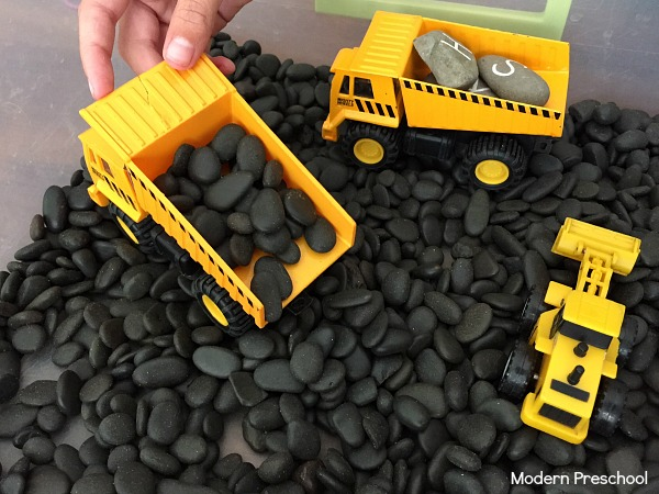 Construction zone simple sensory bin - perfect for toddlers and preschoolers who love construction trucks and playing in rocks!  Great for a transportation or construction theme.
