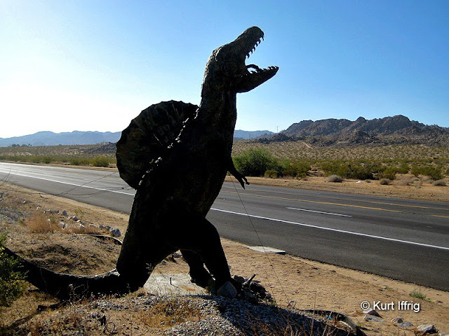 A randomly placed dinosaur beside Twentynine Palms Hwy. There are a few others nearby.
