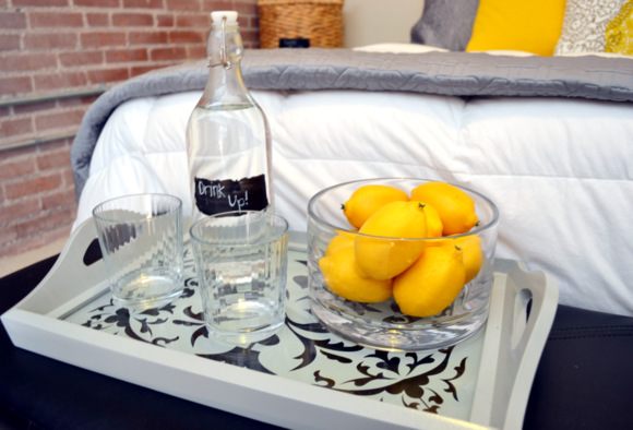 This drinking tray with fresh lemons and cute cups is fun.