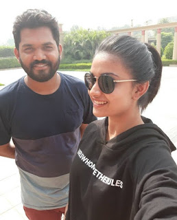 Keerthy Suresh in Black Dress with Cute and Lovely Smile with a Fan