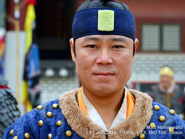 Matt Hahnewald Photography; Facing the World; portrait; street portrait; headshot; outdoor; colour; photography; Asia; East Asia; South Korea; Suwon; Korean swordmanship; martial arts; muyedobotongji; costum; cuture; tradition; Korean man; Hwaseong Haenggung Palace; traditional military attire; martial artist; performer; eye contact; face; eyes; sweat; bokeh; Nikon D3100; Nikkor AF-S 50mm f/1.8G; travel; travel destination; tourism