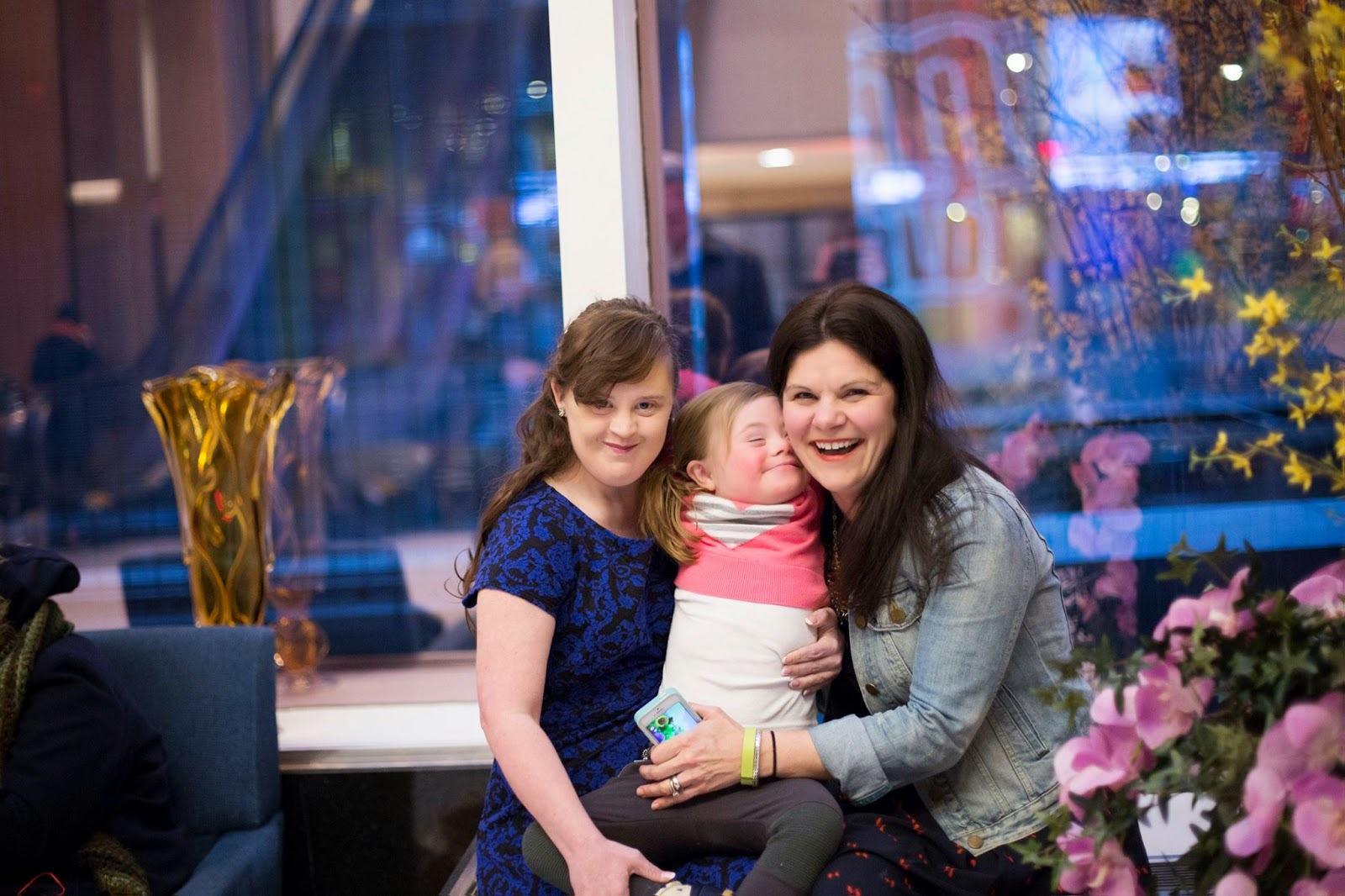 Jamie Brewer with Katie Driscoll and her daughter Gracie.