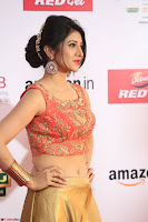 Harshika Ponnacha in orange blouuse brown skirt at Mirchi Music Awards South 2017 ~  Exclusive Celebrities Galleries 077.JPG