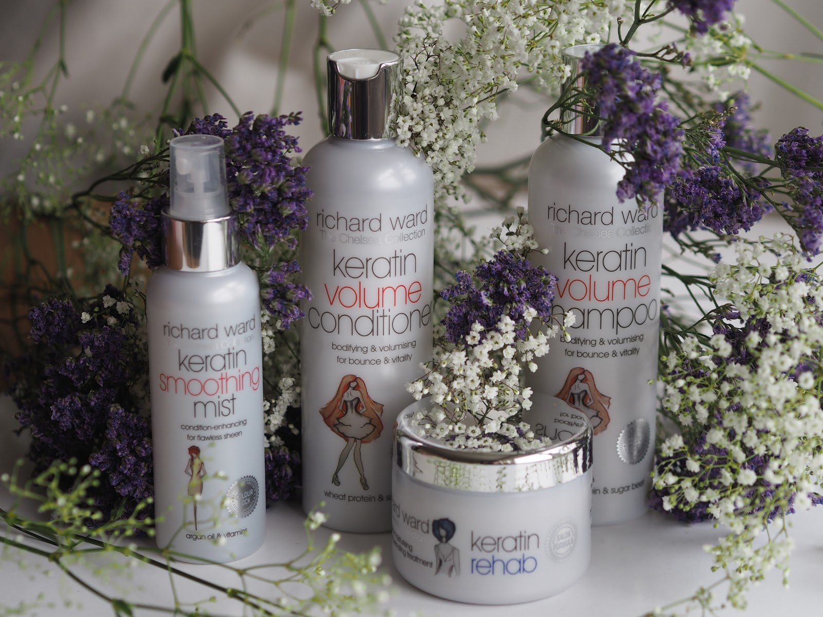 Richard Ward Chelsea Collection Volume series, Shampoo, Conditioner, Spray and Hair Mask against pretty flowers