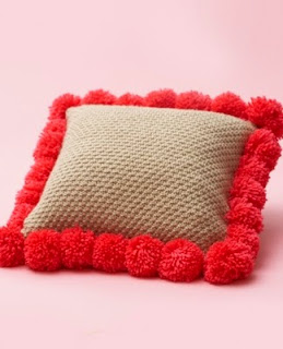 http://www.yarnspirations.com/pattern/knitting/pompom-edged-pillow?utm_source=responsys&utm_medium=email&utm_campaign=back-to-school-dorm-7-29-2014