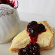 Classic Baked Cheesecake with Blueberry Sauce