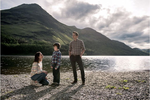 Joe and his mum and dad from the A Word pictured against a backdrop of the lake district