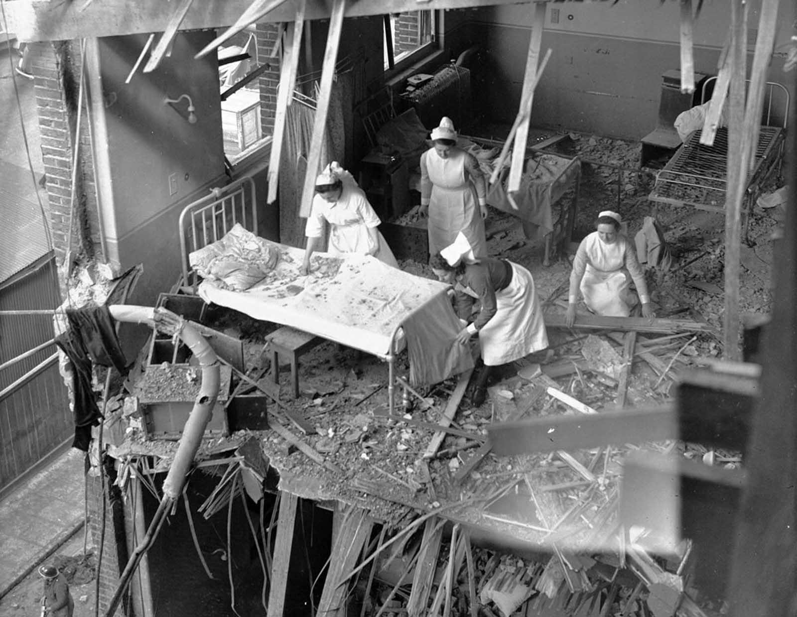 Nurses are seen clearing debris from one of the wards in St. Peter's Hospital, Stepney, East London, on April 19, 1941. Four hospitals were among the buildings hit by German bombs during a full scale attack on the British capital.