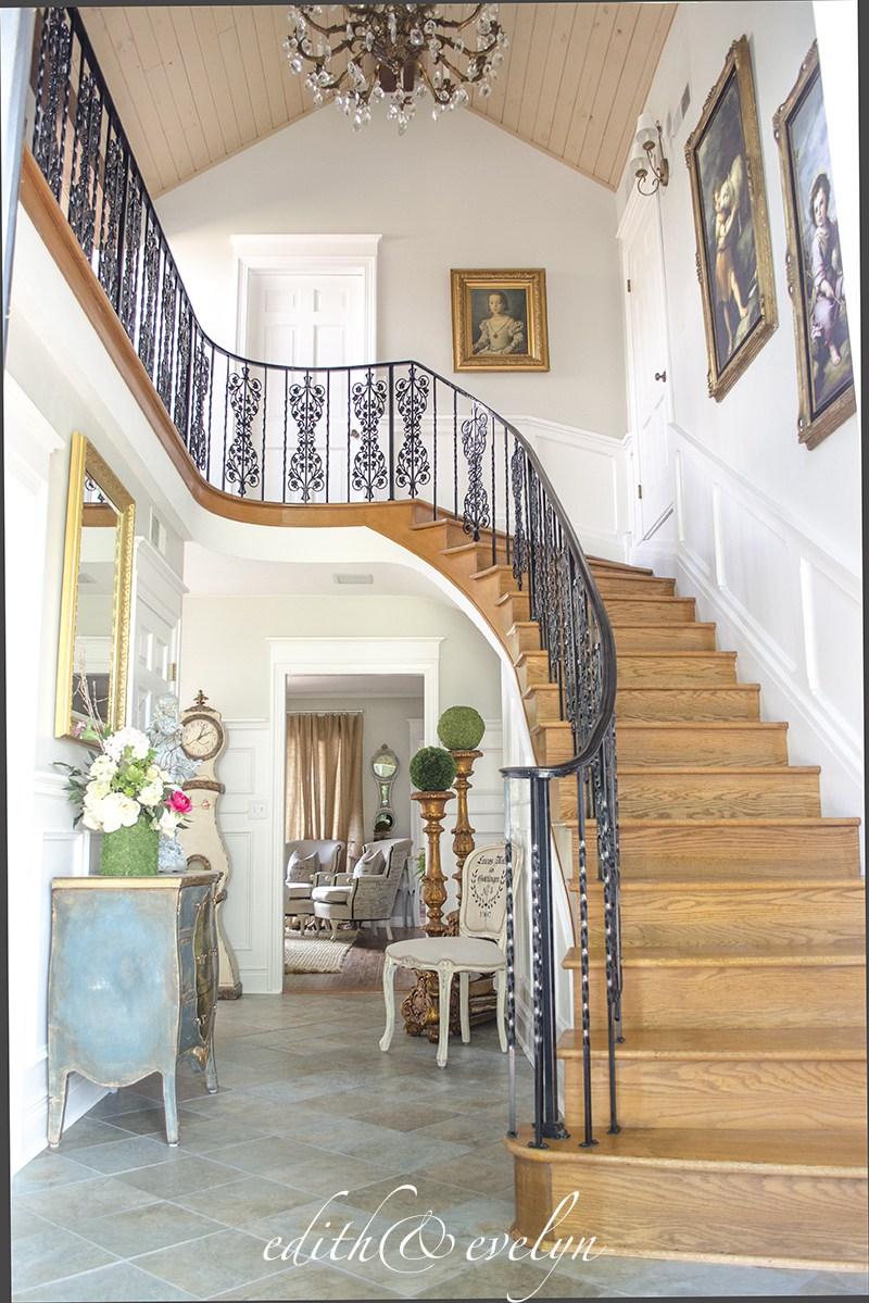 Amazing staircase in a vintage French chateau style home.