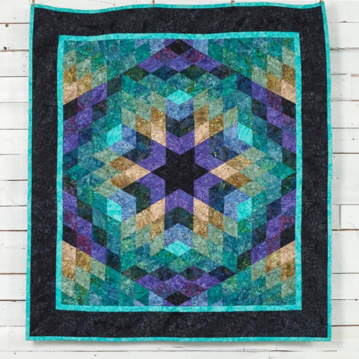 The Facets Batik Quilt Free Pattern designed by Jinny Beyer