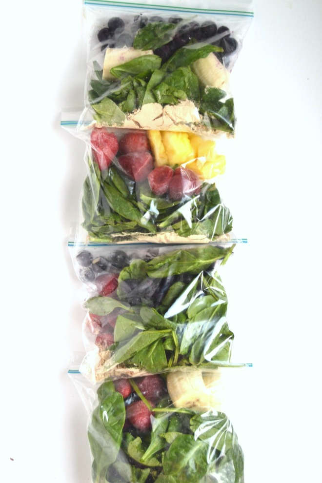 Four make-ahead smoothie pack combinations that are stored right in your freezer! Save time by making these freezer smoothie packs ahead that just require 1 cup of liquid and blending to have breakfast or snack ready in no time. www.nutritionistreviews.com