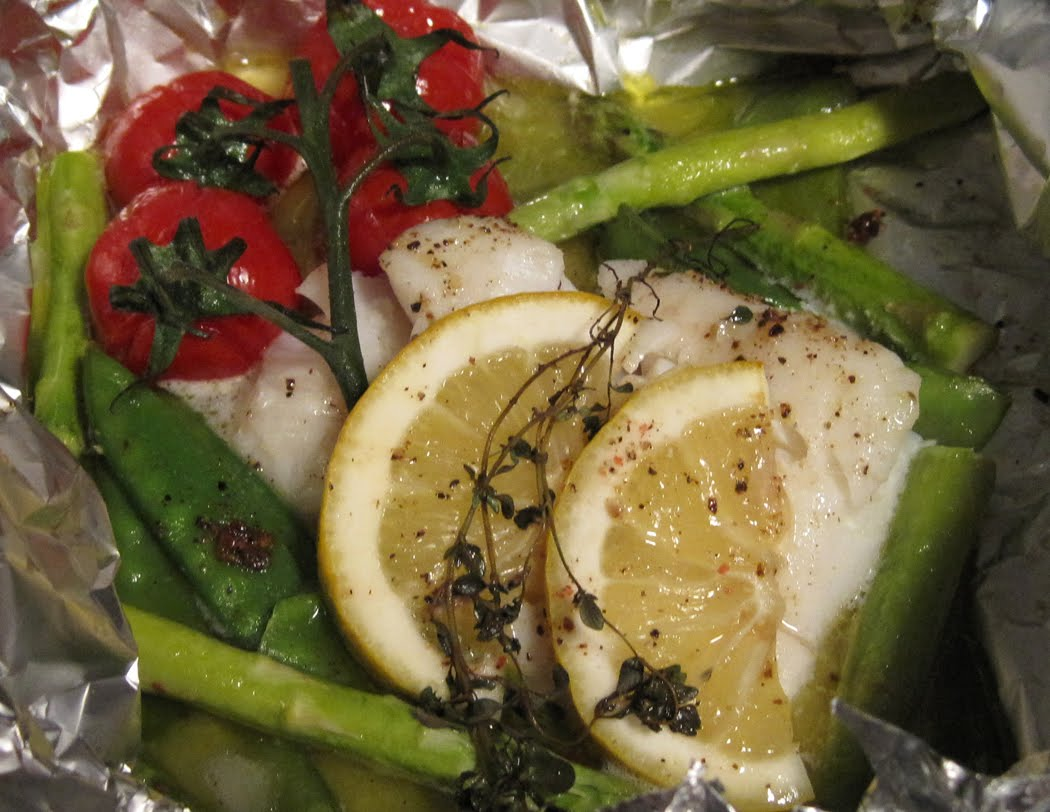 Cod en Papillote with Asparagus Mangetout and Vine Tomatoes