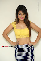 Cute Telugu Actress Shunaya Solanki High Definition Spicy Pos in Yellow Top and Skirt  0011.JPG