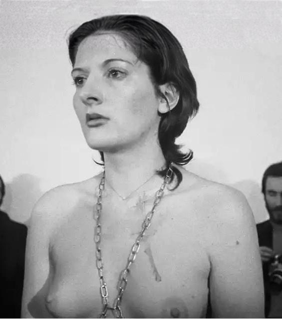 Marina Abramovic, a stripped performance artist in Rhythm 0, 1974