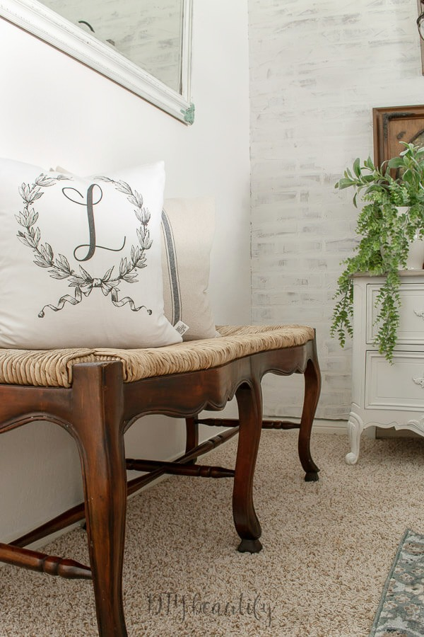 throw pillows on a woven wood bench