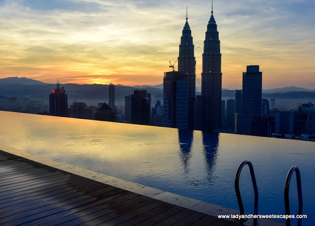 sunrise in Kuala Lumpur, as seen from THE FACE Suites' infinity pool