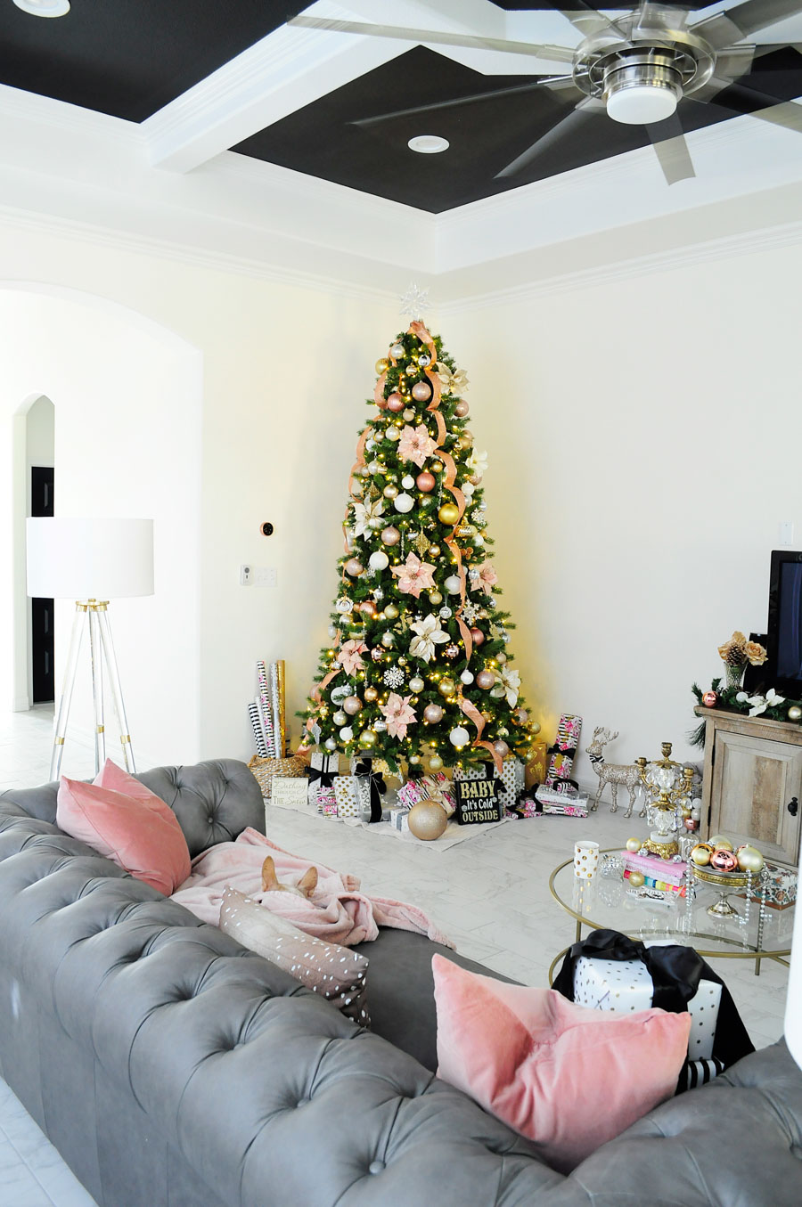 Love this blush, gold, silver and white Christmas tree decor paired with the gray chesterfield Feminine, glam perfection in a living room space.
