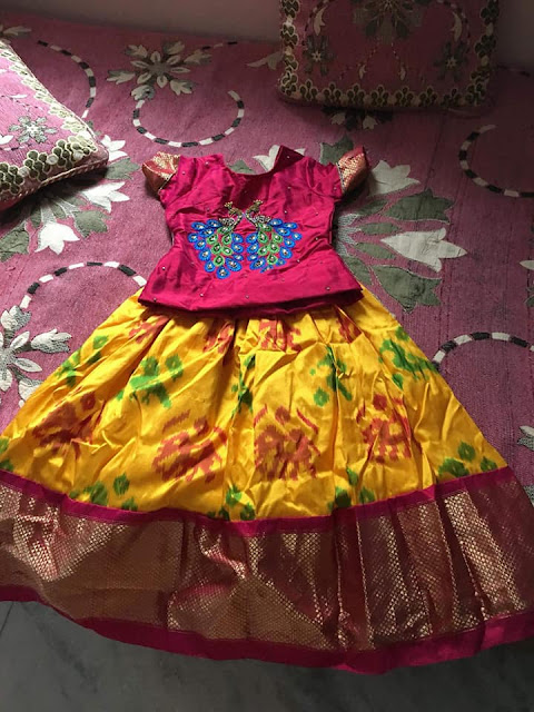 Yellow Ikkat Lehenga Pink Peacock Blouse