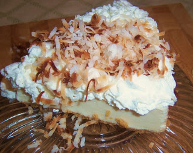 this is an all homemade from scratch  old fashioned style coconut cream pie with whipped cream, coconut custard filling and toasted coconut