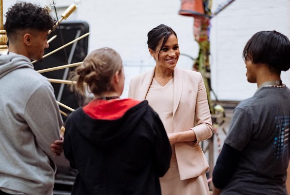 Meghan Markle wore Brandon Maxwell shawl collar blazer and V-Neck midi dress