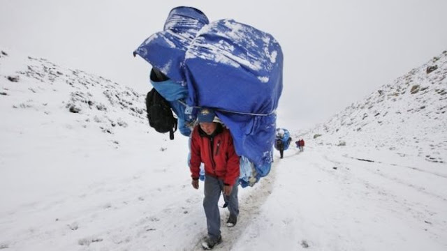 Sherpa and Mount Everest Base Camp