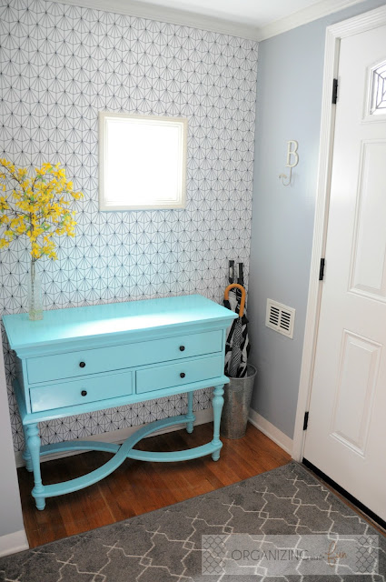 Small entry with pops of turquoise and yellow with geometric patterned wallpaper :: OrganizingMadeFun.com
