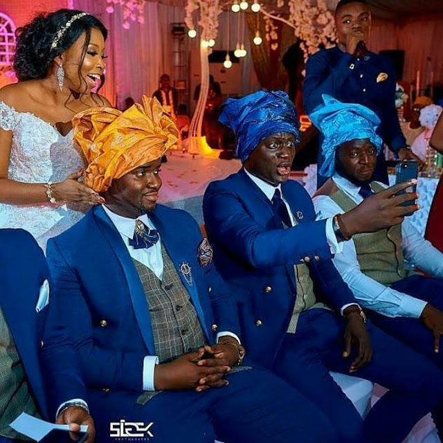 Groom and his groomsmen pictured in head gear during wedding reception