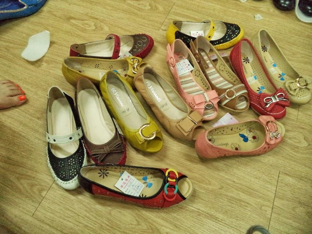 MANGALAM OVERSEAS - Footwear Importers