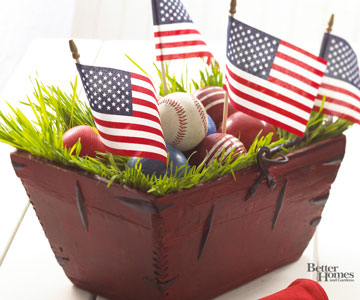 This red basket filled with baseballs and American flags is a great decor piece.