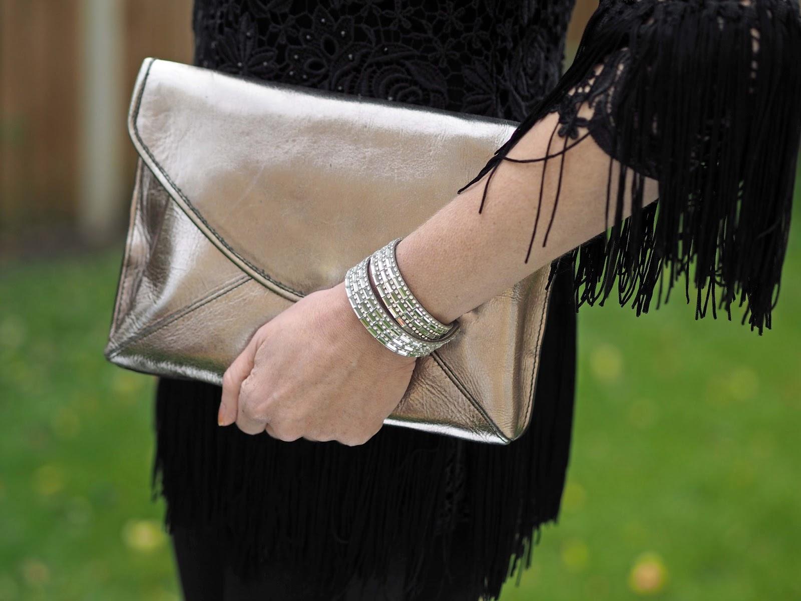 Metallic enevelope clutch bag and grey baguette diamante wrap bracelet, Lizzy O