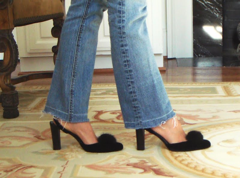 Feet walking in Pom Pom fur shoes