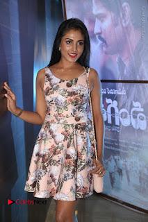 Actress Madhu Shalini Stills in Floral Short Dress at RGV Shiva to Vangaveeti Event  0029.JPG