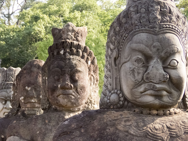 Demons lining the entrance to Angkor Thom City in Cambodia