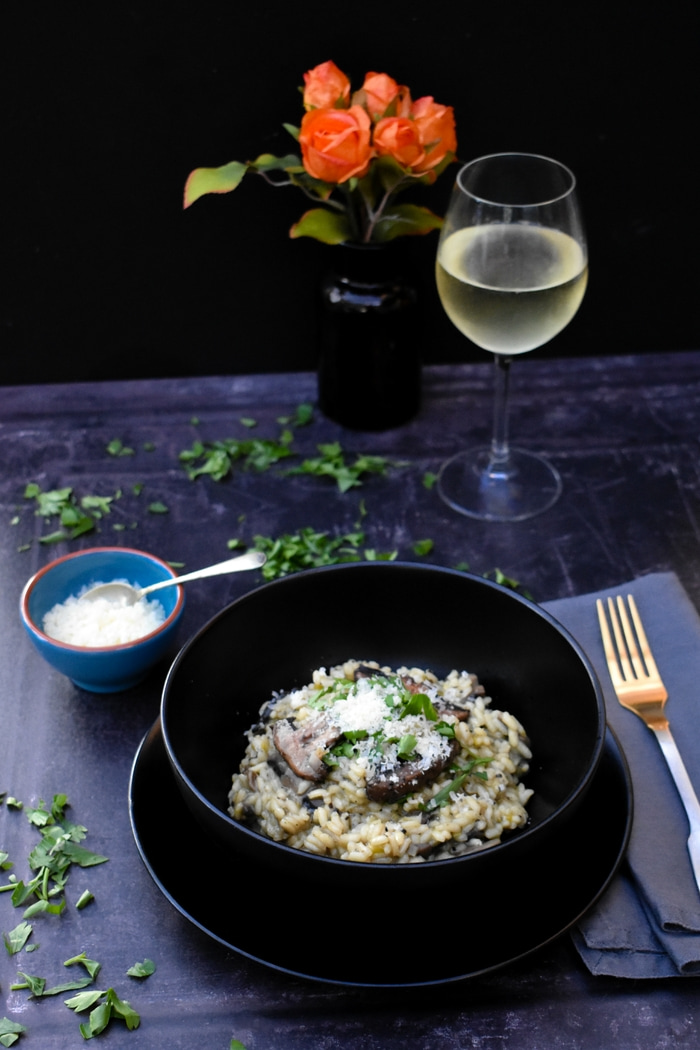 Creamy Mushroom and Leek Risotto topped with vegan style parmesan and fresh parsley